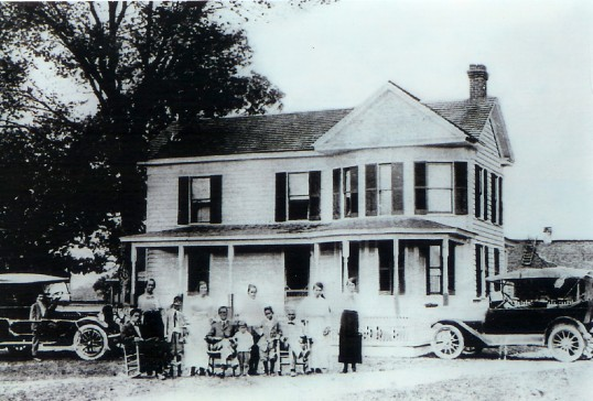 The Nottoway family of Walter Turner poses for an unknown photographer in front of a house in Southampton County in 1918 (Nottoway Indian Tribe of Virginia / Virginia Indian Archive)